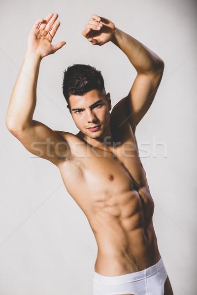 ハンサム 筋肉の 若い男 ポーズ スタジオ セクシー ストックフォト © boggy