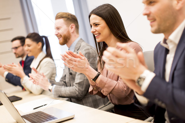 Young business people clapping their hands in office Stock photo © boggy