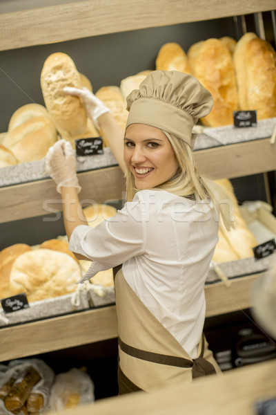 Pretty young woman selling bread in the bakery Stock photo © boggy