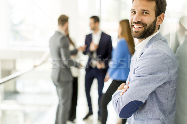 Portrait of handsome young businessman standing Stock photo © boggy