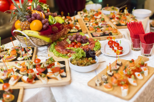 Beautifully decorated catering banquet table with different food Stock photo © boggy