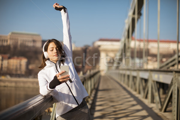 Young athlete woman with mobile phone outdoor Stock photo © boggy