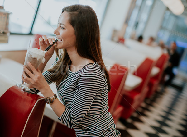 Woman drinks  milkshake at the diner Stock photo © boggy