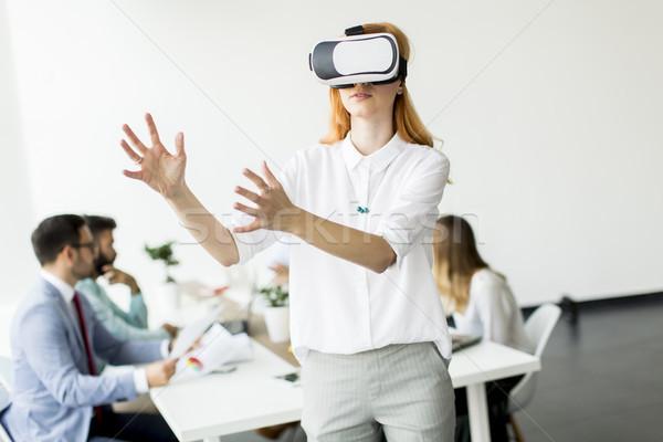 возбужденный деловая женщина виртуальный реальность очки Touch Сток-фото © boggy