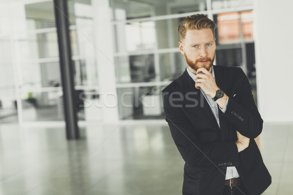 Modern redhair man posing in the office Stock photo © boggy