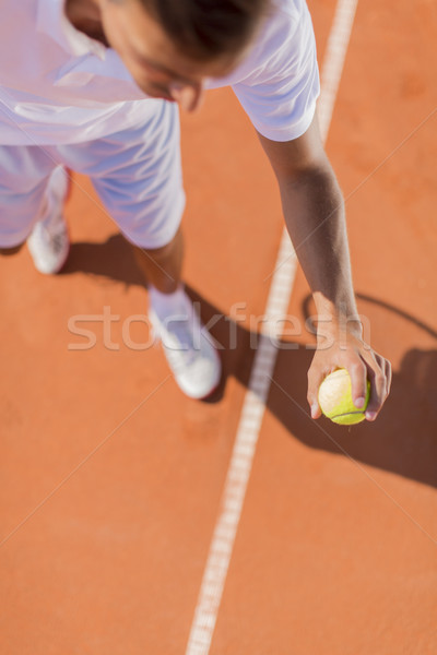 Young man playing tennis Stock photo © boggy