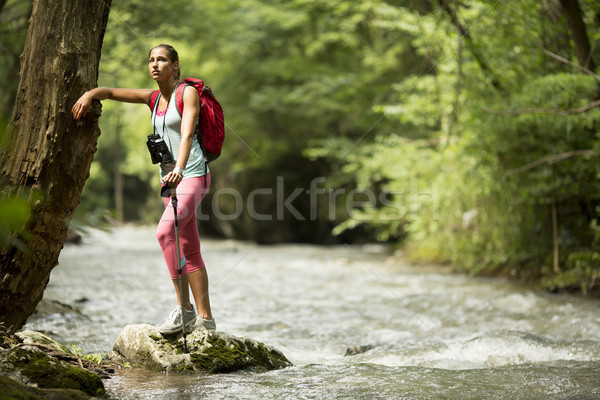 Young woman hiking by the river Stock photo © boggy