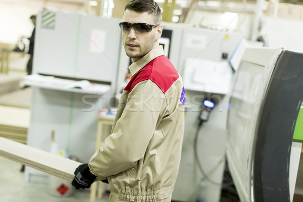 Young man working in furniture factory Stock photo © boggy