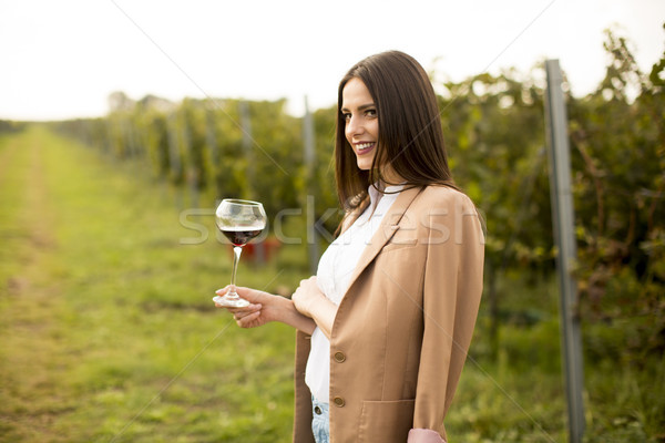 Young woman tasting wine in the vineyard Stock photo © boggy
