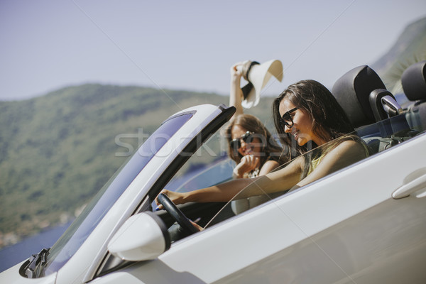 Young women with sunglasses driving her convertible top automobi Stock photo © boggy