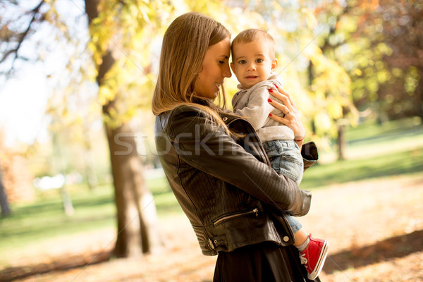Mother and baby boy in autumn park Stock photo © boggy