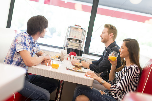 Friends eating in diner Stock photo © boggy