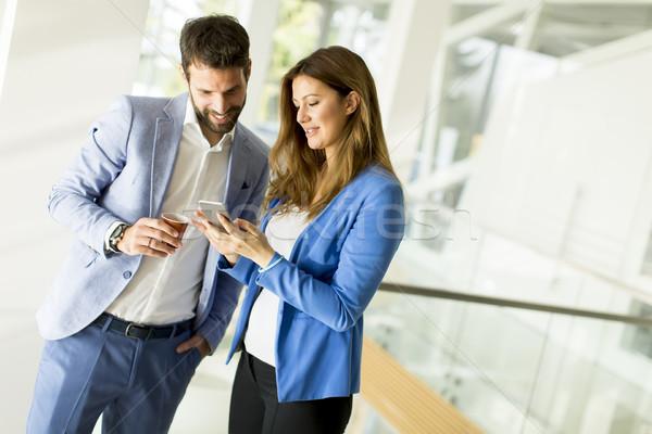 Negocios Pareja mujer de negocios masculina colega Foto stock © boggy