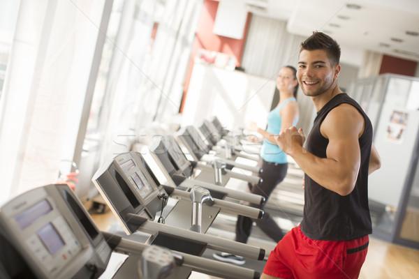 Jogging futópad oldalnézet teljes alakos fiatalember sportruha Stock fotó © boggy