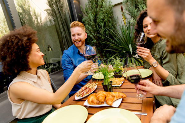 Cheerful young people have lunch in the courtyard and a fun Stock photo © boggy