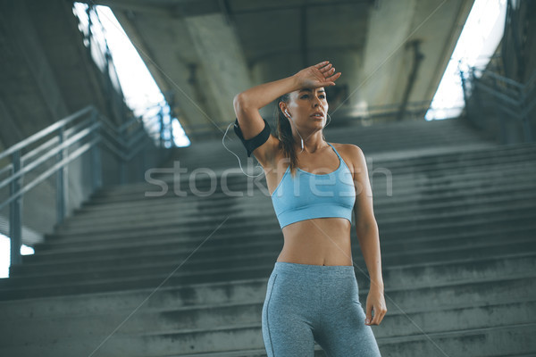 Female runner resting Stock photo © boggy