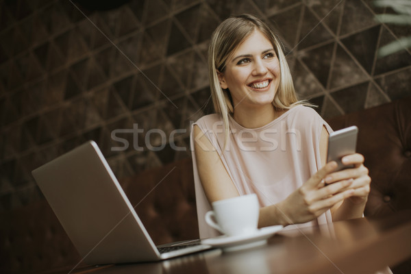 young woman sitting in cafe, drinking coffee and surf the intern Stock photo © boggy