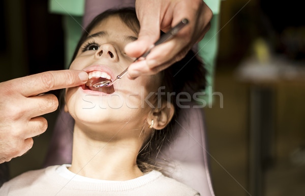 Little girl at the dentist checkup Stock photo © boggy