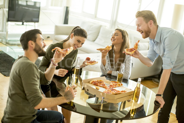 Group of young people eating pizza and drinking cider in the mod Stock photo © boggy