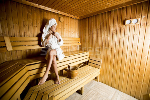 Young woman relaxing in the sauna at spa center Stock photo © boggy