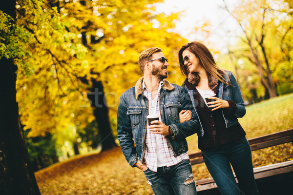 Couple with coffee to go in the park Stock photo © boggy