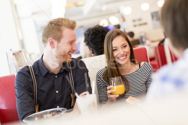 Amigos alimentação diner ver Foto stock © boggy