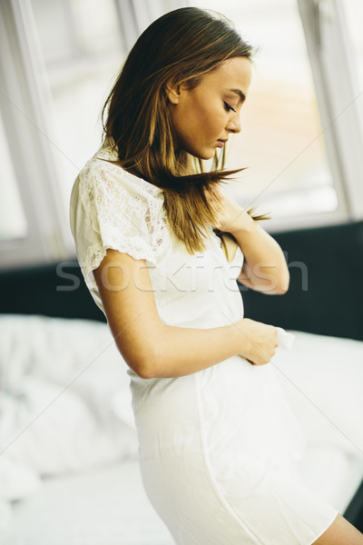 Young woman in the room gets out of bed Stock photo © boggy