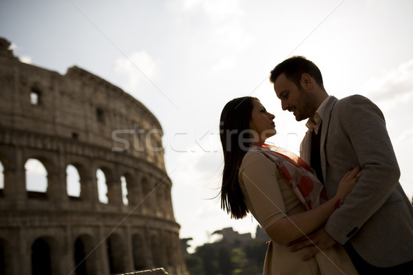 Liefde colosseum Rome zonsondergang vrouw Stockfoto © boggy