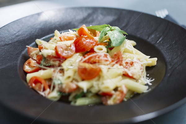 Penne pasta with cheese and cherry tomato Stock photo © boggy