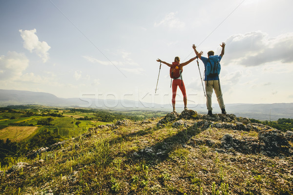 Young couple hiking on the mountain Stock photo © boggy