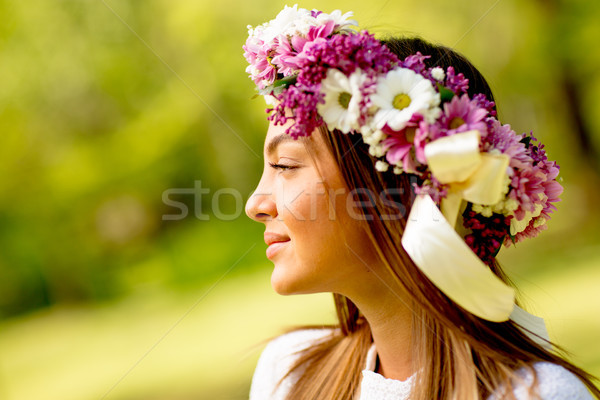 Portrait of young woman with wreath of fresh flowers on head Stock photo © boggy