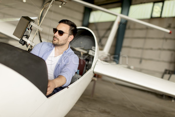 Young pilot checking ultralight airplane before flight Stock photo © boggy