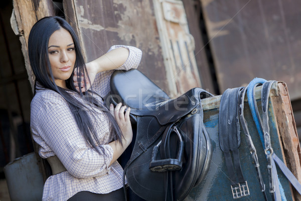 Pretty young woman in the stable Stock photo © boggy