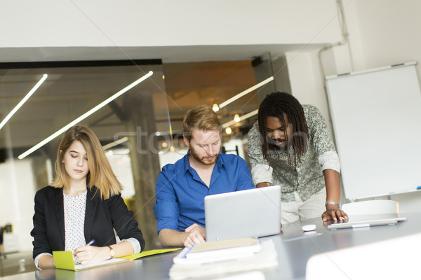 Group of young multiracial people in modern office Stock photo © boggy