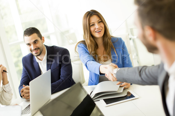 Business people shaking hands, finishing up a meeting Stock photo © boggy