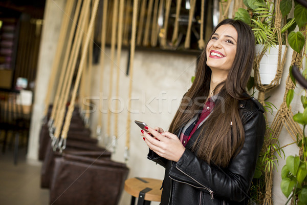 Young woman with mobile phone Stock photo © boggy