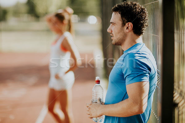 Woman training with personal trainer Stock photo © boggy