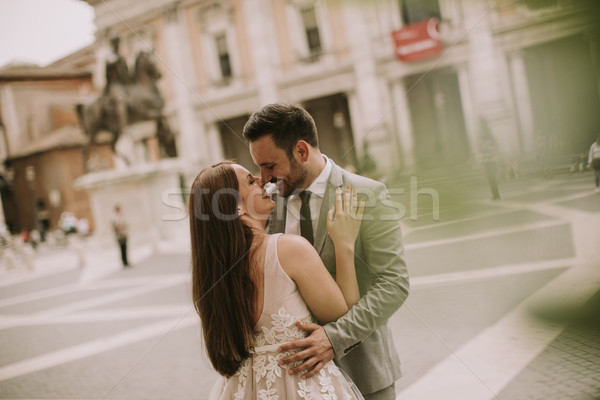 Young wedding couple on Capitoline hill in Rome Stock photo © boggy