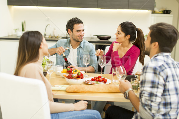 Young people have a meal in the dining room in modern home Stock photo © boggy