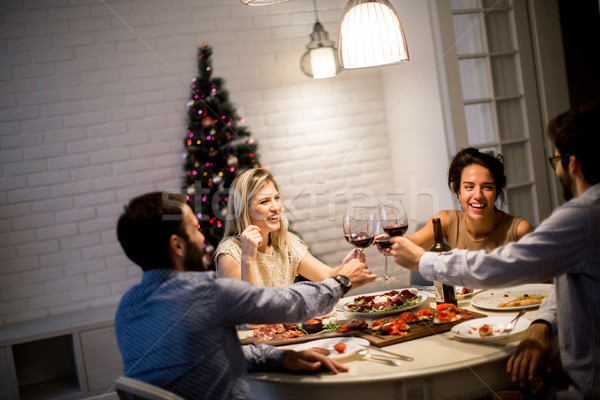 Friends celebrating Christmas or New Year eve Stock photo © boggy