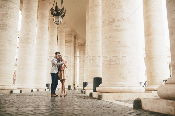 Loving couple at the St. Peter's Square in Vatican Stock photo © boggy
