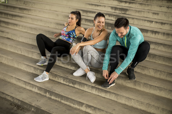 Young people  resting on stairs after training Stock photo © boggy