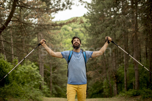 Young bearded man hiking alone on mountain Stock photo © boggy