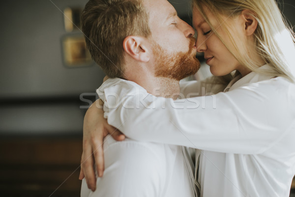 Stock photo: Loving couple kissing in the room