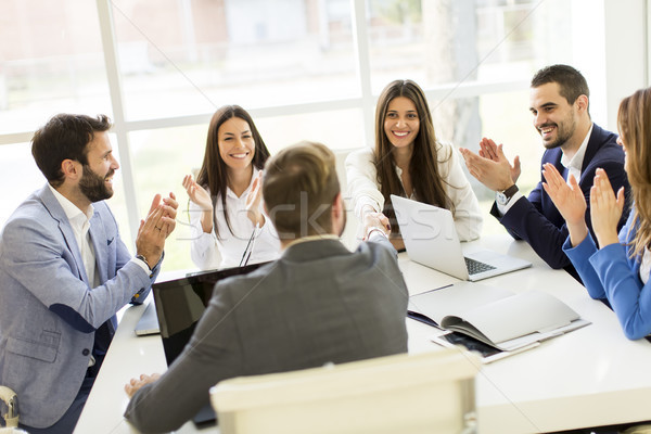 Young business people keeping team building in a modern office Stock photo © boggy