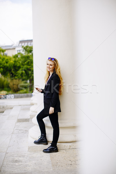 Young woman with mobile phone on the street of Vienna Stock photo © boggy