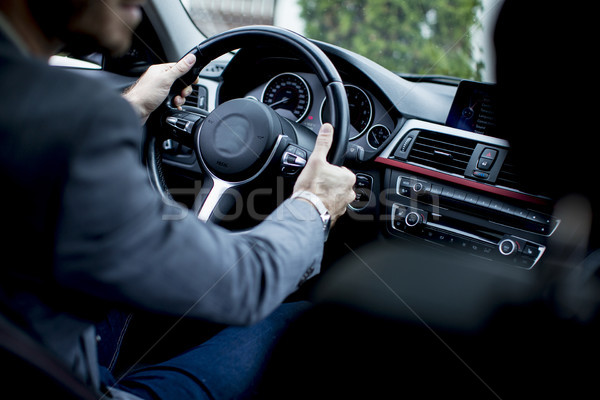 Giovani imprenditore guida moderno auto vista posteriore Foto d'archivio © boggy
