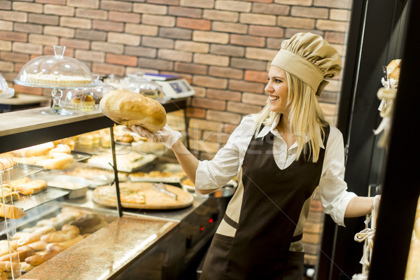 Young woman selling bread in baker shop Stock photo © boggy