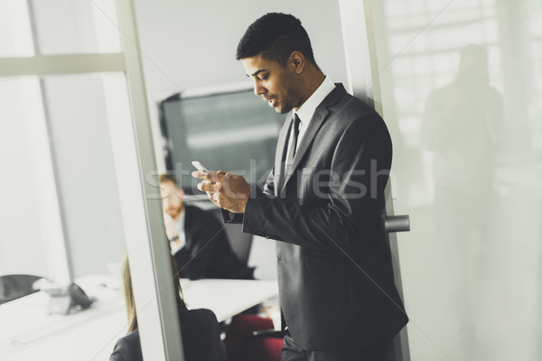 Young African american businessman in office Stock photo © boggy