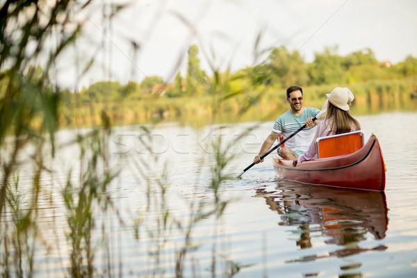 Amorevole Coppia canottaggio lago estate giorno Foto d'archivio © boggy